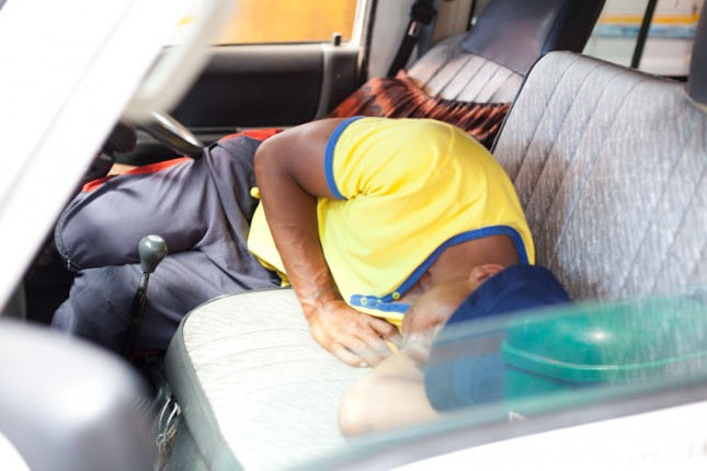 A driver takes a chance to have a short nap.